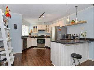 Photo 2: 1290 W 6th Avenue in Vancouver: Fairview VW Townhouse for sale (Vancouver West)  : MLS®# V1128049