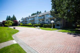 "Photo 1: 107 13959 16 Avenue in Surrey: Crescent Bch Ocean Pk. Condo for sale in ""White Rock Village (Wiltshire House)"" (South Surrey White Rock)  : MLS®# R2458078"
