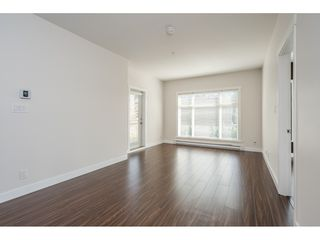 "Photo 7: 213 13468 KING GEORGE Boulevard in Surrey: Whalley Condo for sale in ""BROOKLAND"" (North Surrey)  : MLS®# R2526441"