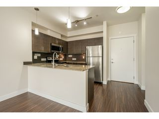 "Photo 3: 213 13468 KING GEORGE Boulevard in Surrey: Whalley Condo for sale in ""BROOKLAND"" (North Surrey)  : MLS®# R2526441"
