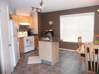 Photo 3: 210 MCKENZIE TOWNE Link SE in CALGARY: McKenzie Towne Townhouse for sale (Calgary)  : MLS®# C3551979