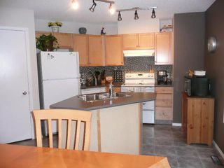 Photo 2: 210 MCKENZIE TOWNE Link SE in CALGARY: McKenzie Towne Townhouse for sale (Calgary)  : MLS®# C3551979