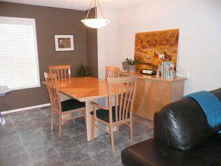Photo 4: 210 MCKENZIE TOWNE Link SE in CALGARY: McKenzie Towne Townhouse for sale (Calgary)  : MLS®# C3551979