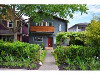 Photo 1: 1085 E 15TH AV in Vancouver: Mount Pleasant VE House for sale (Vancouver East)  : MLS®# V1012064