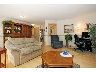 "Photo 8: 105 20240 54A Avenue in Langley: Langley City Condo for sale in ""Arbutus Court"" : MLS®# F1315776"