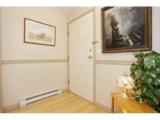 "Photo 4: 105 20240 54A Avenue in Langley: Langley City Condo for sale in ""Arbutus Court"" : MLS®# F1315776"