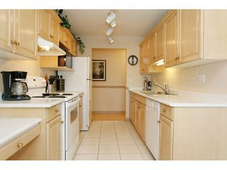 "Photo 13: 105 20240 54A Avenue in Langley: Langley City Condo for sale in ""Arbutus Court"" : MLS®# F1315776"