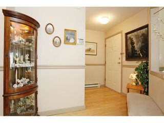 "Photo 5: 105 20240 54A Avenue in Langley: Langley City Condo for sale in ""Arbutus Court"" : MLS®# F1315776"