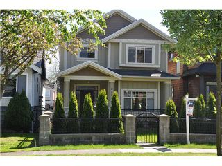Photo 1: 888 W 61ST Avenue in Vancouver: Marpole House for sale (Vancouver West)  : MLS®# V946909