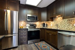 Photo 5: 403 15340 19A Avenue in Surrey: King George Corridor Condo for sale (South Surrey White Rock)  : MLS®# R2353532