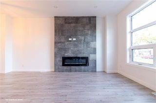 Photo 6: 1002 Redwood Avenue in Winnipeg: Single Family Detached for sale (4B)  : MLS®# 1925617