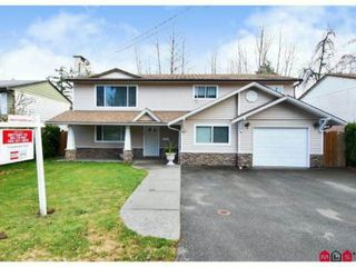 Photo 1: 10310 143RD Street in Surrey: Whalley House for sale (North Surrey)  : MLS®# F1228954
