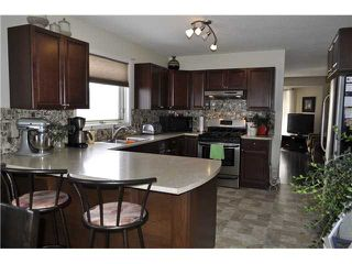 Photo 7: 69 WOODSIDE Road NW: Airdrie Residential Detached Single Family for sale : MLS®# C3563262