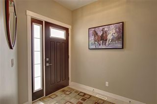Photo 2: 88 SIERRA MORENA Manor SW in Calgary: Signal Hill Semi Detached for sale : MLS®# C4292022