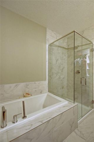 Photo 18: 88 SIERRA MORENA Manor SW in Calgary: Signal Hill Semi Detached for sale : MLS®# C4292022