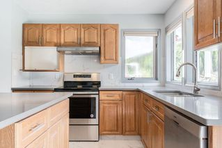 Photo 15: 86 RIVERVIEW Circle: Cochrane Detached for sale : MLS®# C4299466