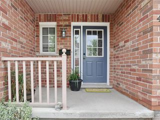 Photo 2: 40 320 AMBLESIDE Drive in London: North A Residential for sale (North)  : MLS®# 275541