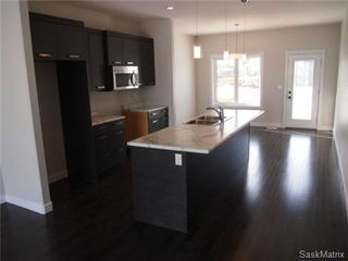 Photo 10: 417 Quessy Drive: Martensville Single Family Dwelling for sale (Saskatoon NW)  : MLS®# 457864