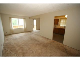 Photo 3: 7712 HUNTERVIEW Drive NW in CALGARY: Huntington Hills 4Plex for sale (Calgary)  : MLS®# C3630605