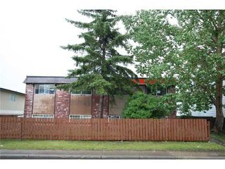Photo 1: 7712 HUNTERVIEW Drive NW in CALGARY: Huntington Hills 4Plex for sale (Calgary)  : MLS®# C3630605