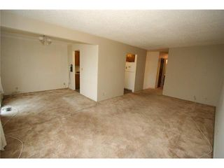 Photo 4: 7712 HUNTERVIEW Drive NW in CALGARY: Huntington Hills 4Plex for sale (Calgary)  : MLS®# C3630605