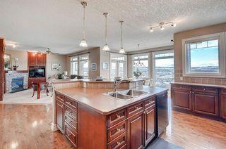Photo 8: 83 HIDDEN CREEK PT NW in Calgary: Hidden Valley House for sale : MLS®# C4282209