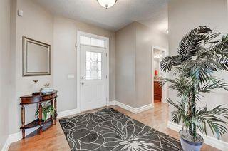 Photo 3: 83 HIDDEN CREEK PT NW in Calgary: Hidden Valley House for sale : MLS®# C4282209
