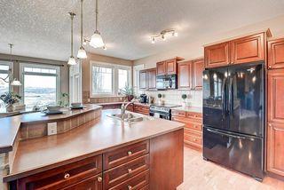 Photo 9: 83 HIDDEN CREEK PT NW in Calgary: Hidden Valley House for sale : MLS®# C4282209