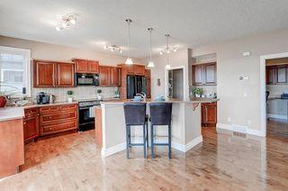 Photo 10: 83 HIDDEN CREEK PT NW in Calgary: Hidden Valley House for sale : MLS®# C4282209