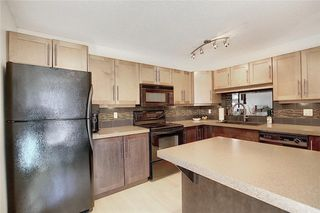 Photo 5: 901 3240 66 Avenue SW in Calgary: Lakeview Row/Townhouse for sale : MLS®# C4295935