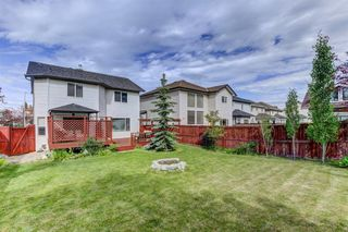 Photo 2: 516 ROCKY RIDGE Drive NW in Calgary: Rocky Ridge Detached for sale : MLS®# A1012891