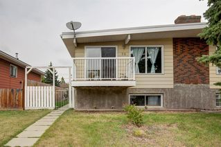 Main Photo: 69 QUEEN ISABELLA Close SE in Calgary: Queensland Semi Detached for sale : MLS®# A1031564