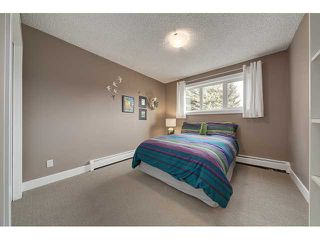 Photo 17: 702 3130 66 Avenue SW in CALGARY: Lakeview Townhouse for sale (Calgary)  : MLS®# C3554805