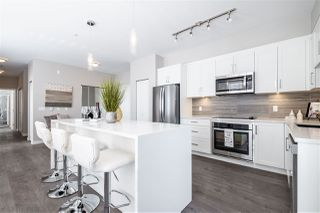 """Photo 1: F404 20211 66 Avenue in Langley: Willoughby Heights Condo for sale in """"Elements"""" : MLS®# R2427986"""