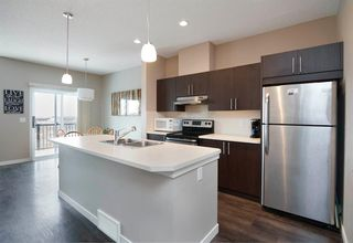 Photo 3: 1604 881 Sage Valley Boulevard NW in Calgary: Sage Hill Row/Townhouse for sale : MLS®# A1032743