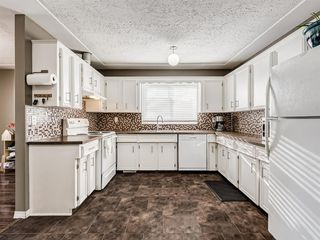 Photo 7: 107 Ranchero Place NW in Calgary: Ranchlands Detached for sale : MLS®# A1049917