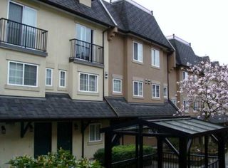 """Photo 1: 32 1561 BOOTH Avenue in Coquitlam: Maillardville Townhouse for sale in """"THE COURCELLES"""" : MLS®# V942779"""