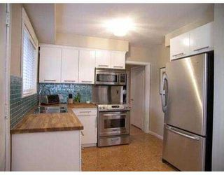 Photo 8: 7019 BURFORD ST in Burnaby: Upper Deer Lake House for sale (Burnaby South)  : MLS®# V585360
