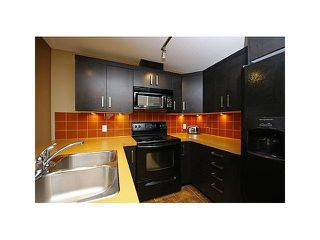 Photo 4: 1703 - 1410 1 Street SE in Calgary: Beltline Condo for sale : MLS®# C3609862