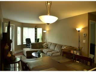 "Photo 3: 202 3063 IMMEL Street in Abbotsford: Central Abbotsford Condo for sale in ""CLAYBURN RIDGE"" : MLS®# F1416681"