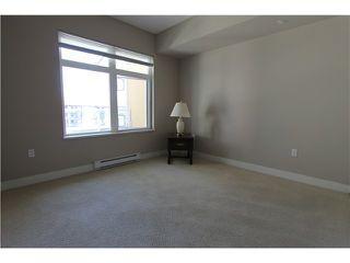 "Photo 11: 415 2368 MARPOLE Avenue in Port Coquitlam: Central Pt Coquitlam Condo for sale in ""RIVERROCK LANDING"" : MLS®# V1019170"
