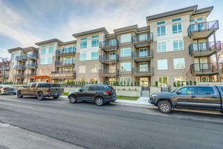 "Photo 1: 311 2382 ATKINS Avenue in Port Coquitlam: Central Pt Coquitlam Condo for sale in ""Parc East"" : MLS®# R2418133"