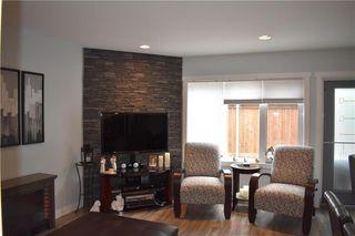 Photo 2: 2 908 Headmaster Row in Winnipeg: Condominium for sale (3H)  : MLS®# 202013029