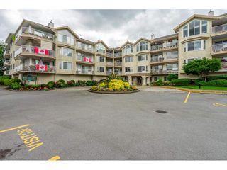 "Photo 1: 208 20600 53A Avenue in Langley: Langley City Condo for sale in ""RIVER GLEN ESTATE"" : MLS®# R2469647"