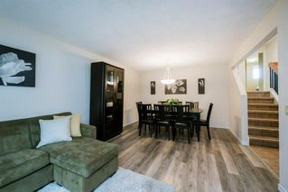 Photo 6: 8 STRATHCLAIR Rise SW in Calgary: Strathcona Park Detached for sale : MLS®# A1022810