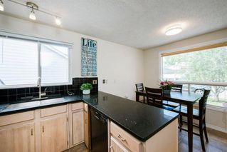 Photo 10: 8 STRATHCLAIR Rise SW in Calgary: Strathcona Park Detached for sale : MLS®# A1022810