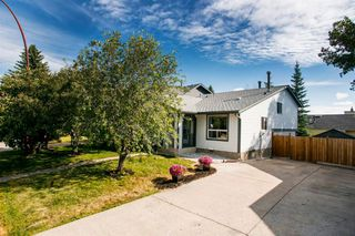 Photo 2: 8 STRATHCLAIR Rise SW in Calgary: Strathcona Park Detached for sale : MLS®# A1022810