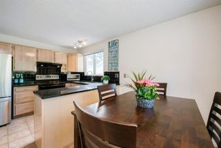 Photo 11: 8 STRATHCLAIR Rise SW in Calgary: Strathcona Park Detached for sale : MLS®# A1022810