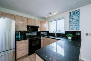 Photo 9: 8 STRATHCLAIR Rise SW in Calgary: Strathcona Park Detached for sale : MLS®# A1022810