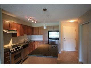 "Photo 3: 426 19673 MEADOW GARDENS Way in Pitt Meadows: North Meadows Condo for sale in ""THE FAIRWAYS"" : MLS®# V952865"